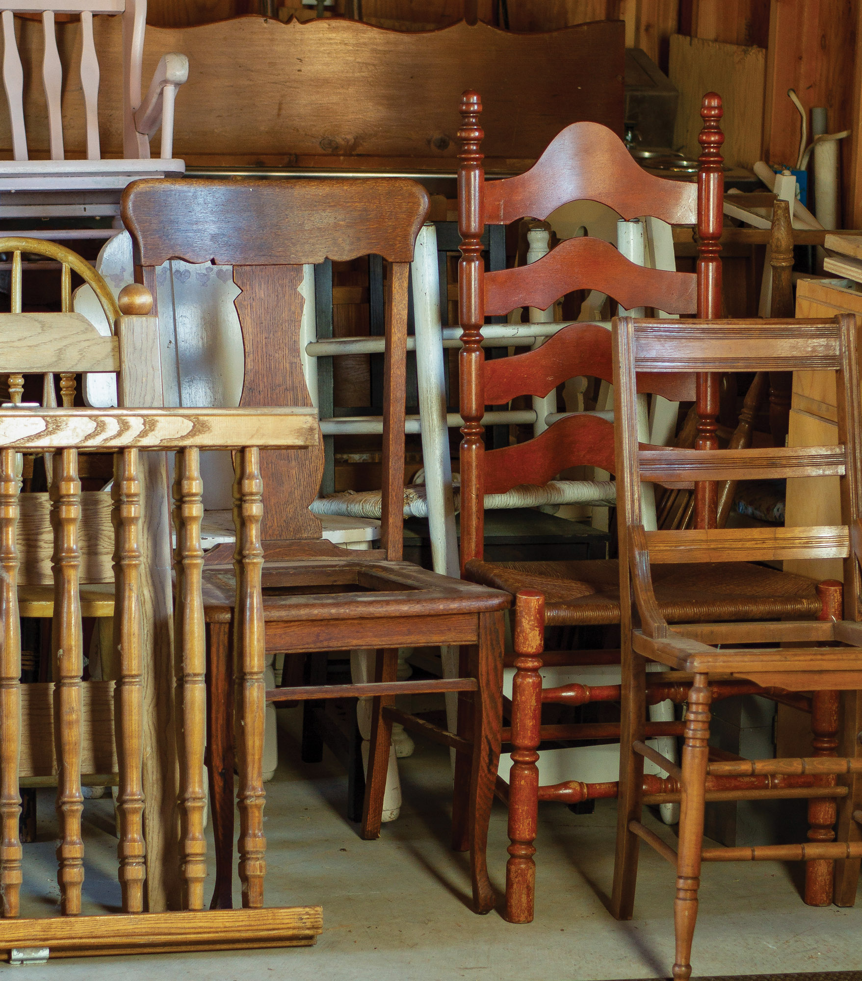 A collection of old chairs.