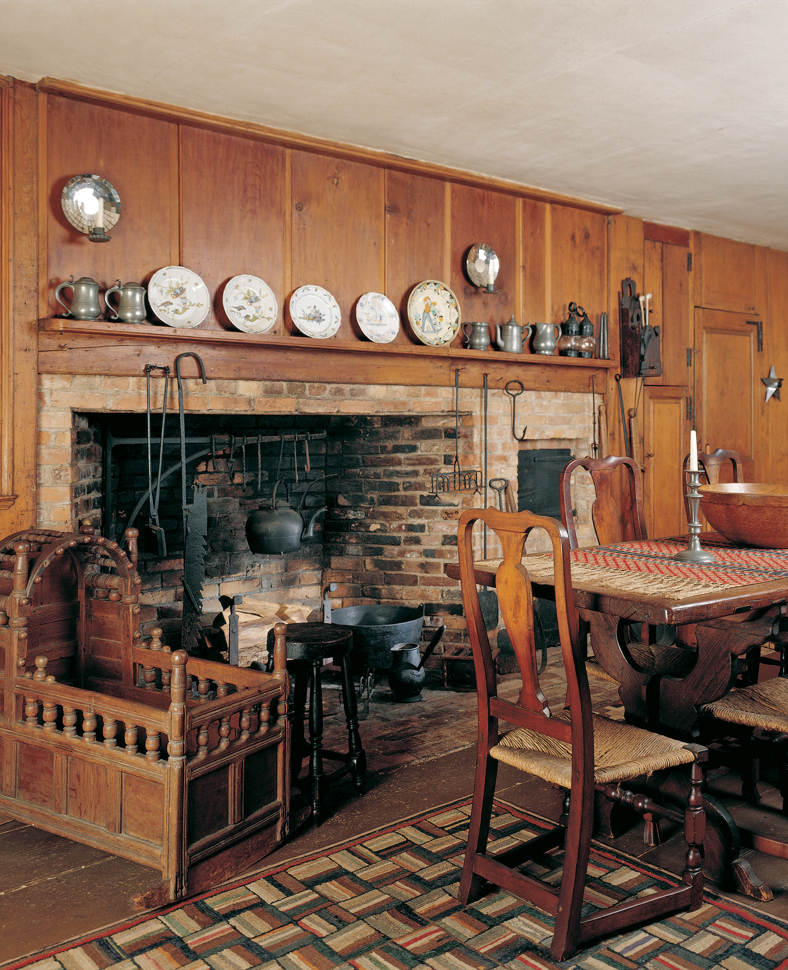 The 1930s owner used the old kitchen as her dining room, moving the fireplace oven for dramatic impact, stripping the woodwork, and decorating with pewter and ceramics.