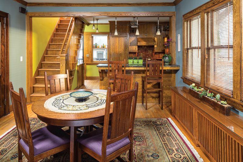 The dining room has reissued Stickley furniture, an enclosure from The Wooden Radiator Cabinet Company, and an Arts & Crafts-inspired rug with a stylized Celtic design.
