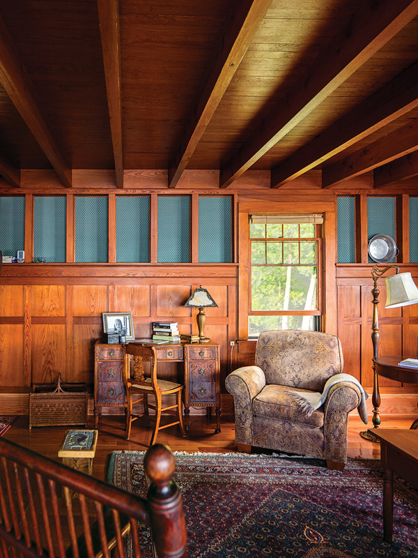 Most of the furniture in the lakeside cabin came from the couple's former house in Burlington, including the desk in the living room.