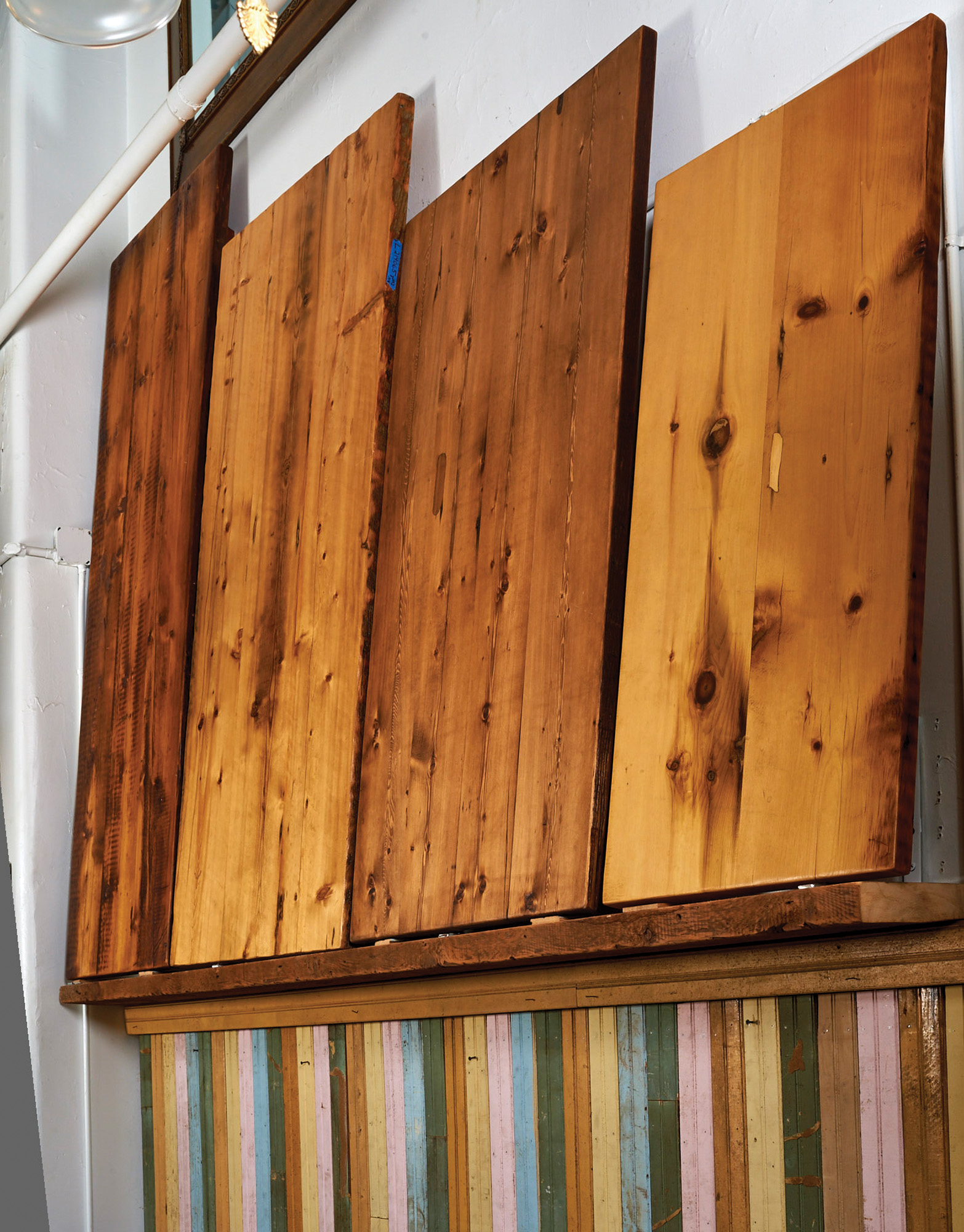 Wood tabletops from scrap lumber: awaiting reuse, samples on display at Olde Good Things in New York City.