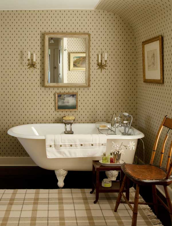 Once a spare room, the guest bath is pleasantly old-fashioned, with a footed tub and a small-print wallpaper.
