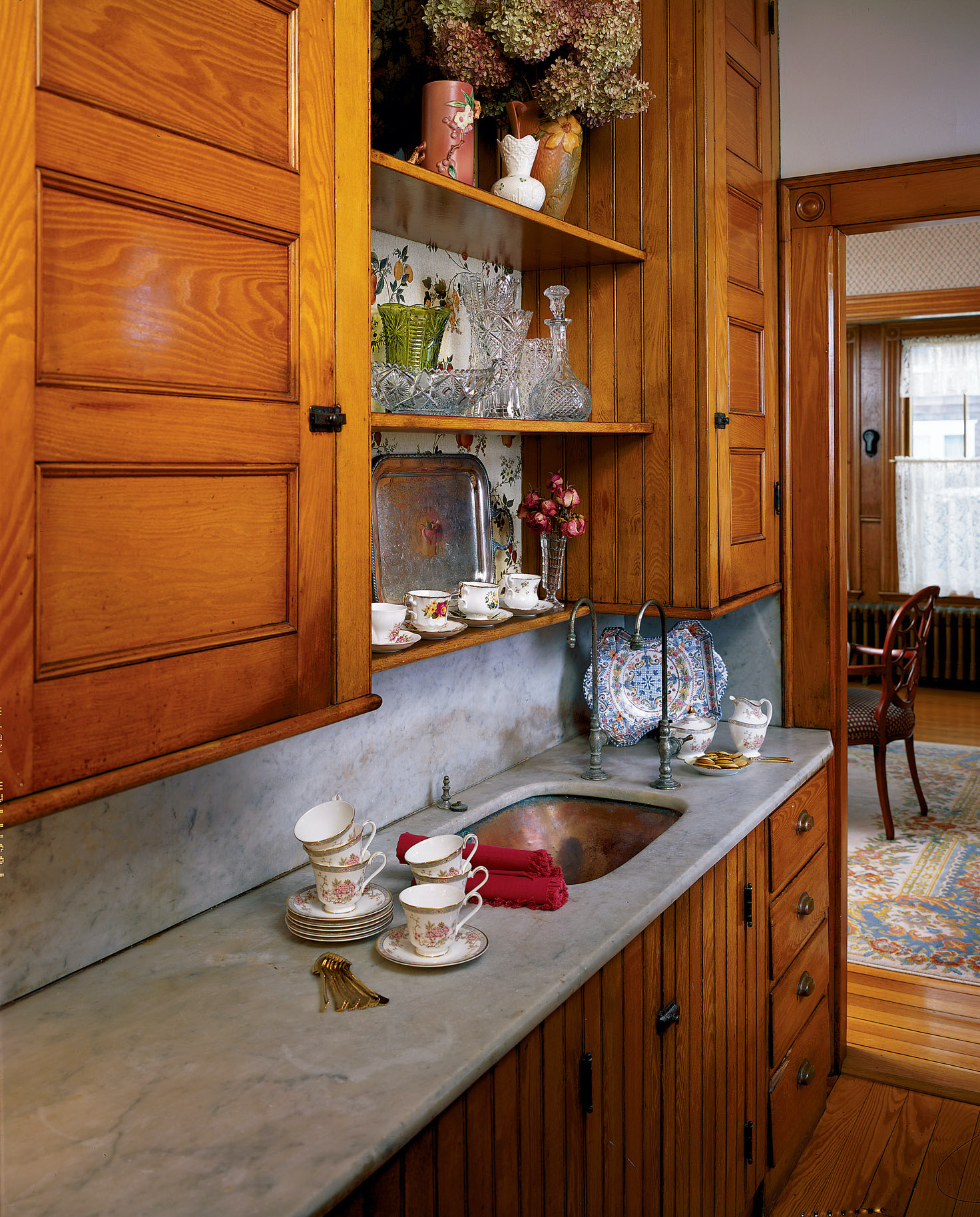 The copper sink in this late-19th-century pantry is still in good shape, even compared to the marble counter, which shows some staining and pitting.