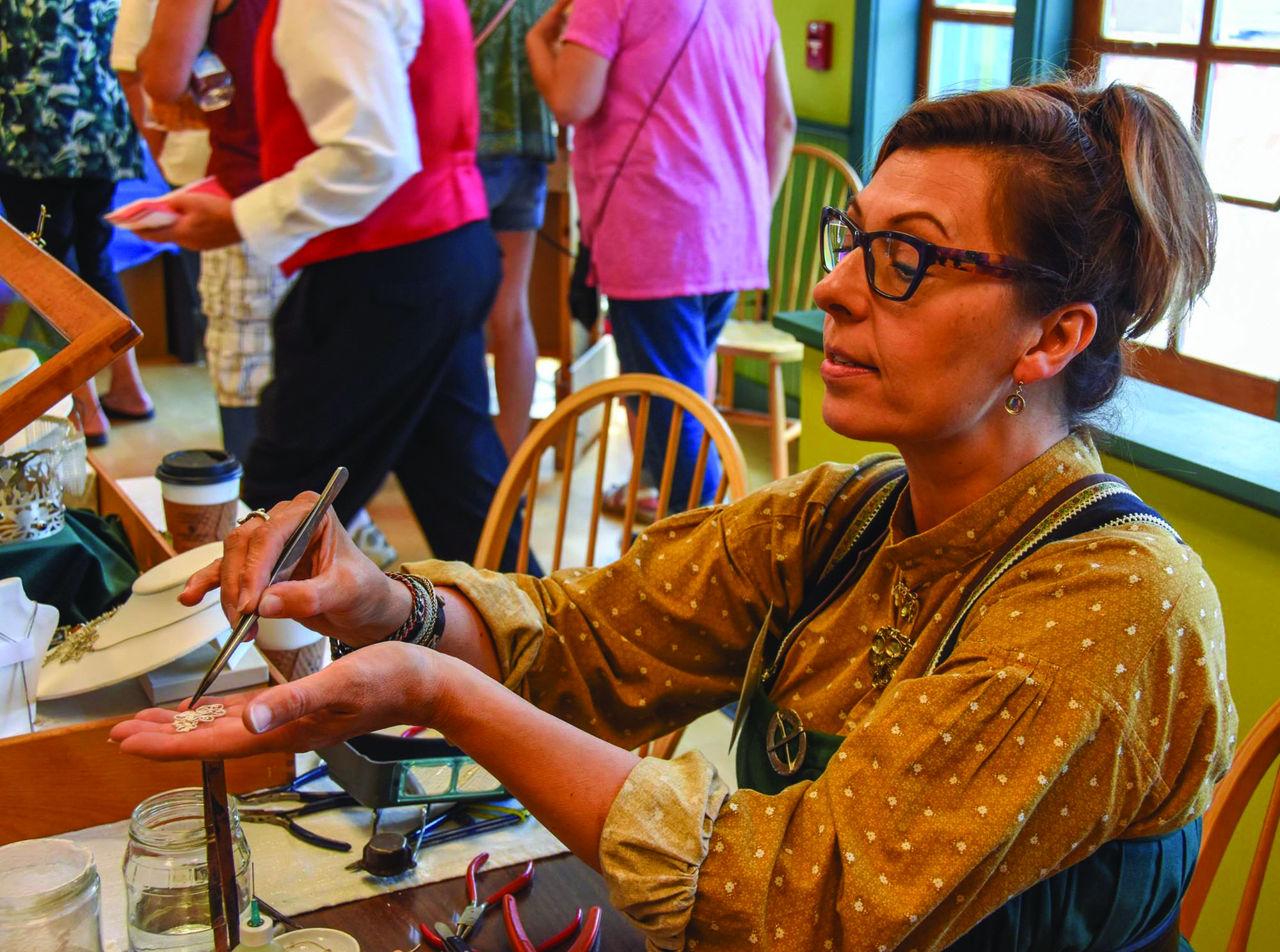 Liz Burcheit leads workshops in making traditional Nordic jewelry.