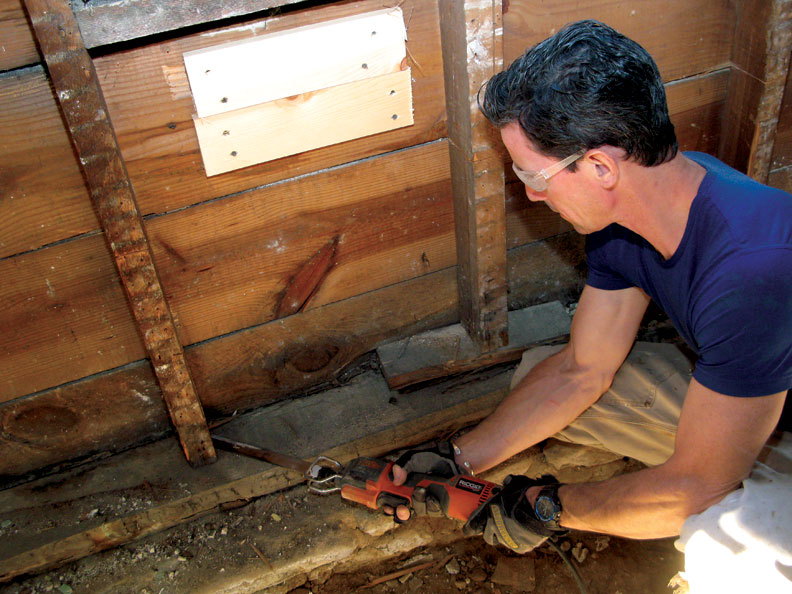 A recip saw is just the tool for removing a rotted sill plate and studs—and cutting through nails around them—to replace these damaged structural members.