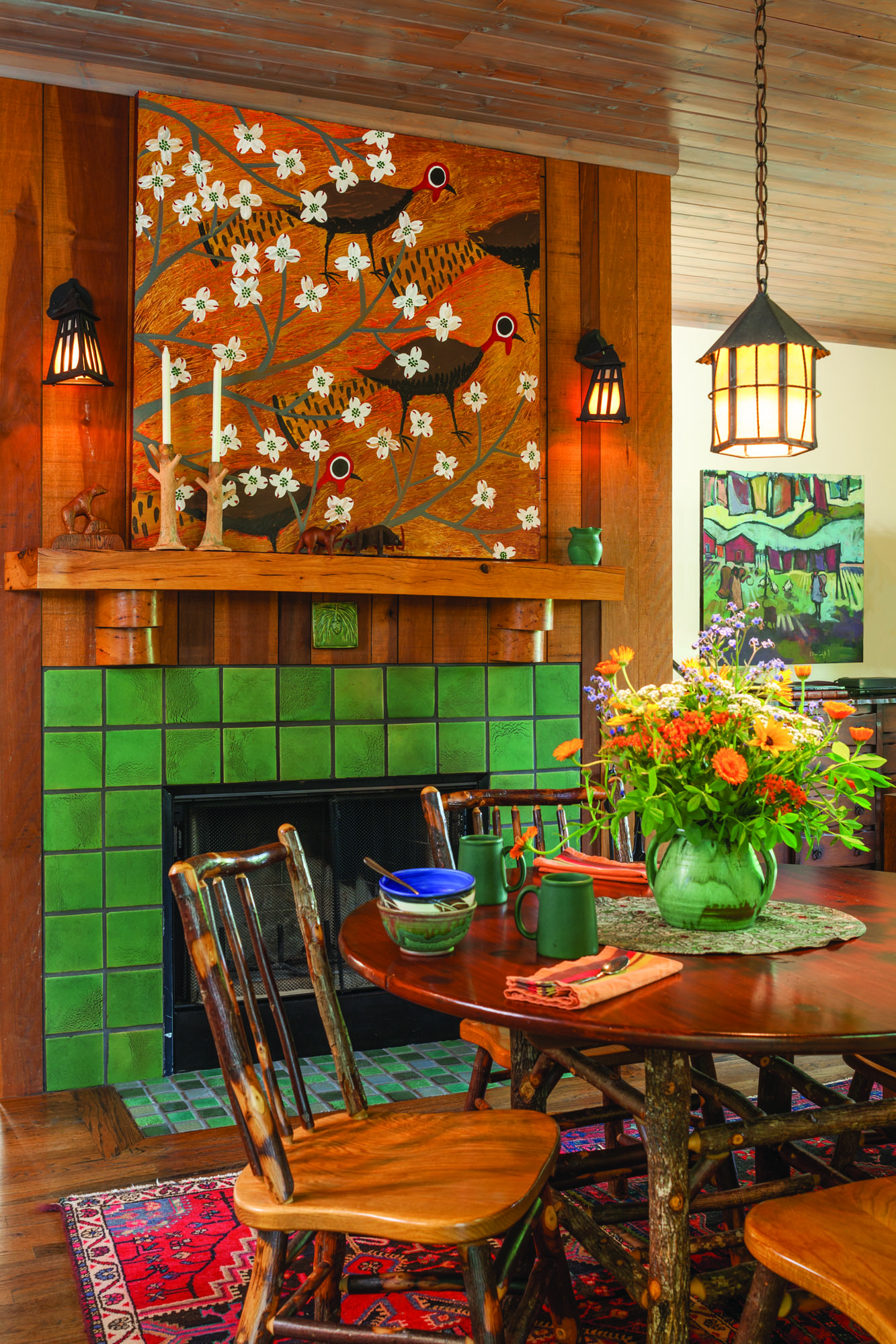 The Amish-made table and chairs are hickory; lantern and sconces are ca. 1920; the North Carolina double-handled pot is vintage.