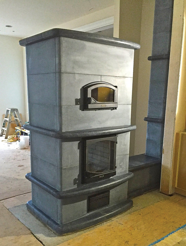 Heat the house and cook dinner with the same load of wood with M. Teixeira's Sinatra masonry soapstone heater.