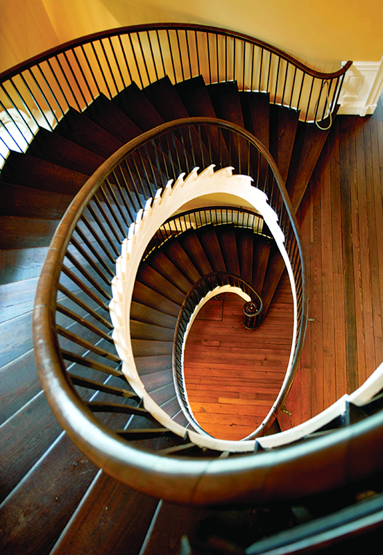 The freestanding spiral staircase in the 1808 Nathaniel Russell house in Charleston, S.C., begins with a volute and has a continuous handrail.