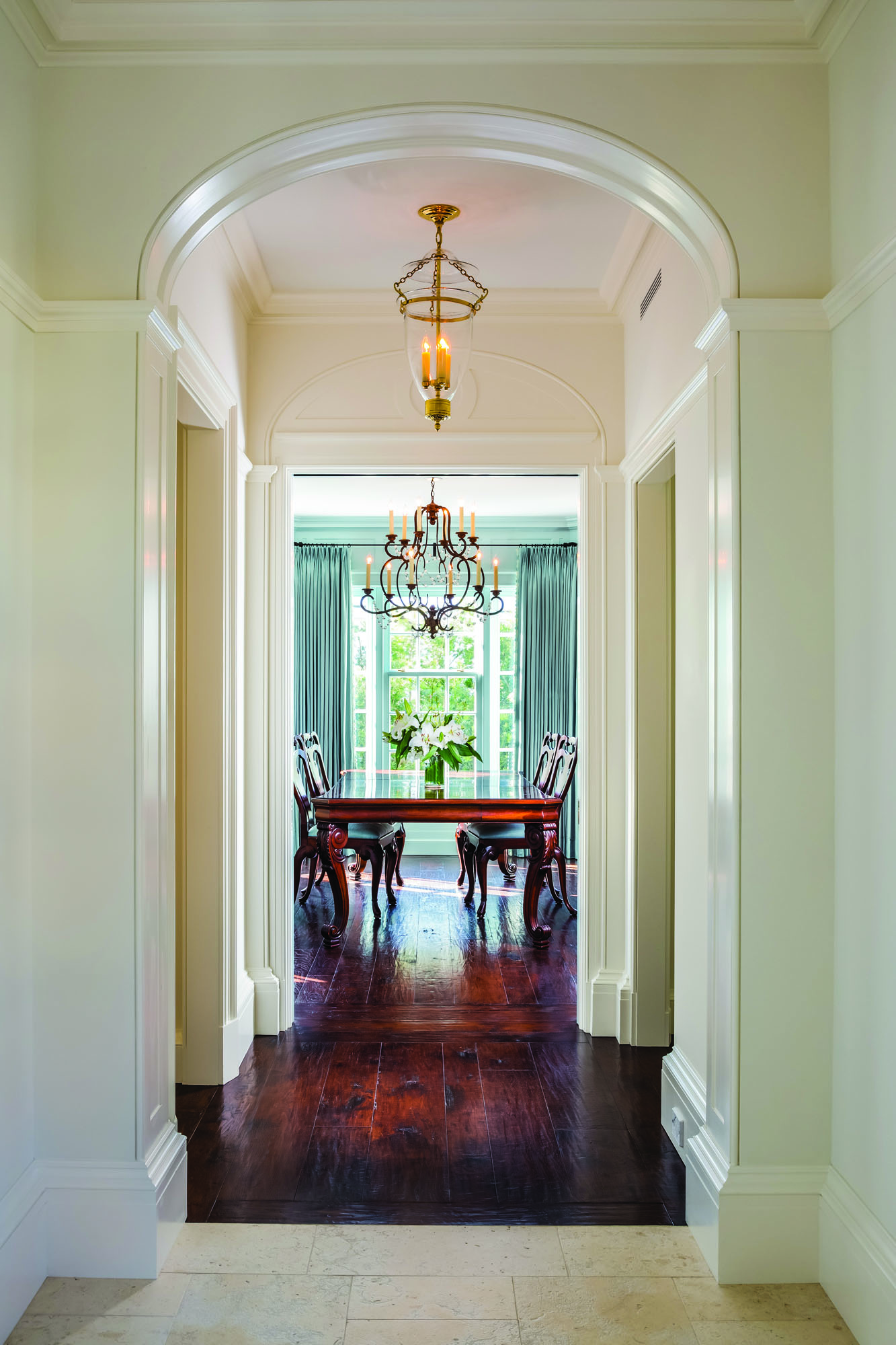 Dark stained wood floors contrast with the crisp white paint.