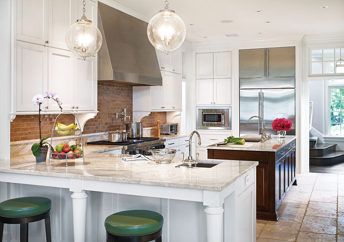 A limestone floor and plentiful windows brighten the kitchen.