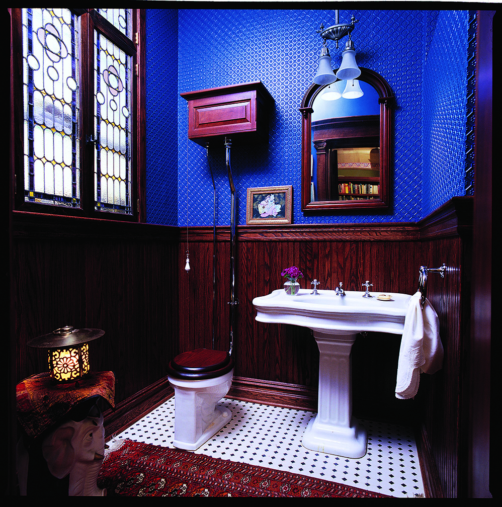 Dark woodwork and moody blue Lincrusta carry a Victorian feeling to a new bath.