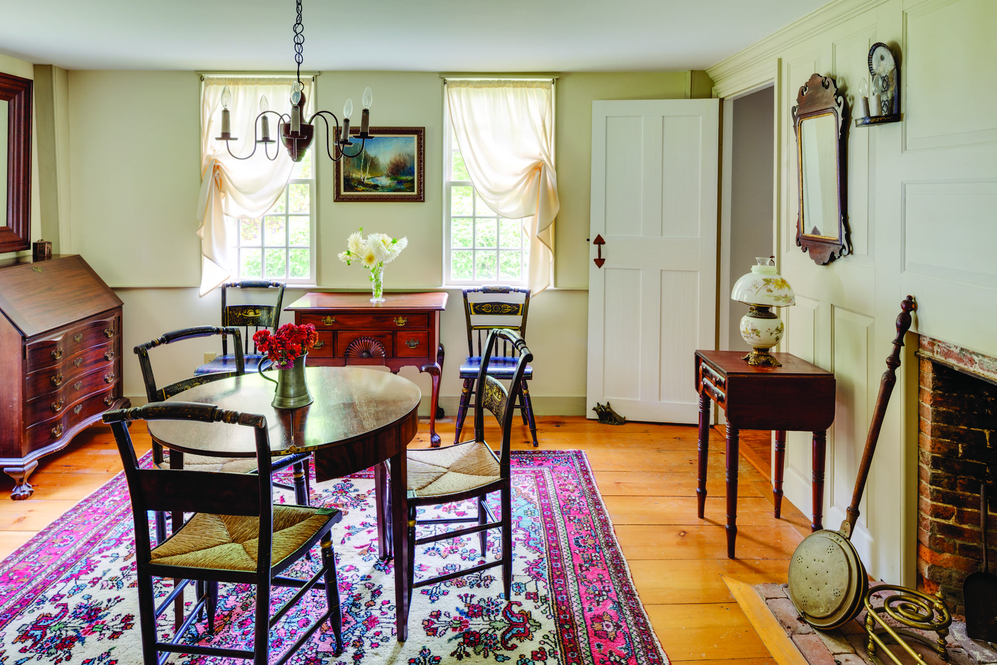 The east parlor is the more formal of the two front rooms. It is furnished with Colonial Revival furniture that had been in the owner's family.