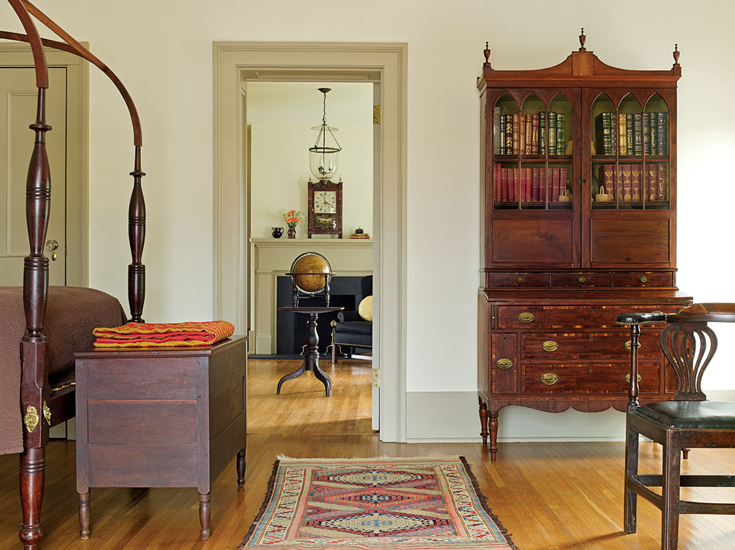 A 19th-century Sheraton field bed and a Massachusetts secretary.