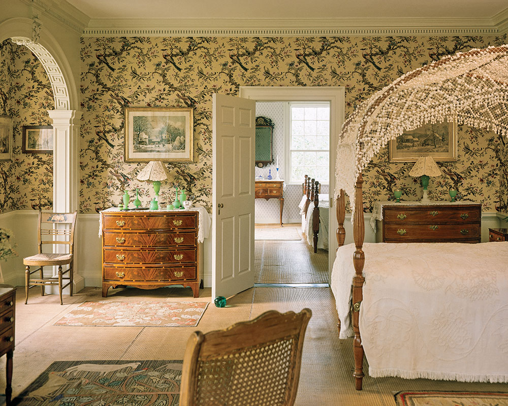 A bedroom is filled with Colonial Revival conventions.