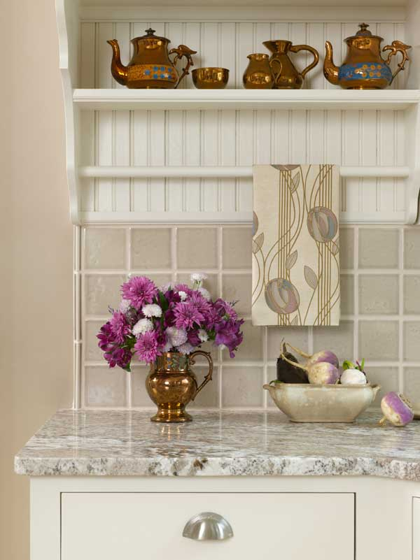 A bracketed shelf holds lusterware; towel pattern is Mackintosh's 'Loch Aire Voile.'