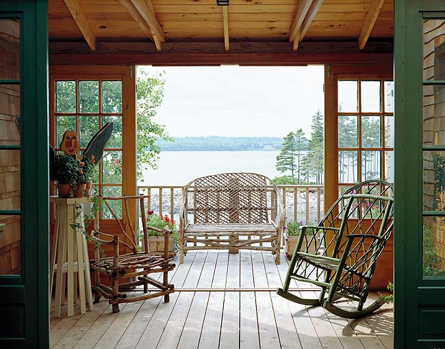 A breezeway opens onto an open porch, which offers views of the water beyond.