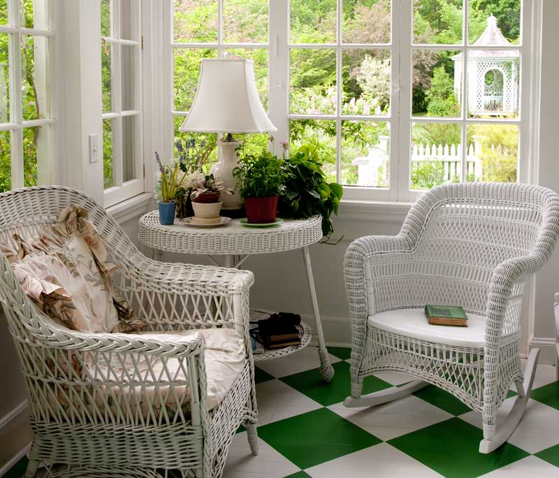 A bright green-and-white floor lends cheer to a garden room in bloom year-round.