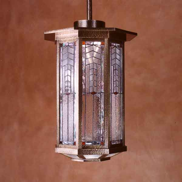 A bronze and art glass pendant from Crenshaw Lighting was originally a custom order.