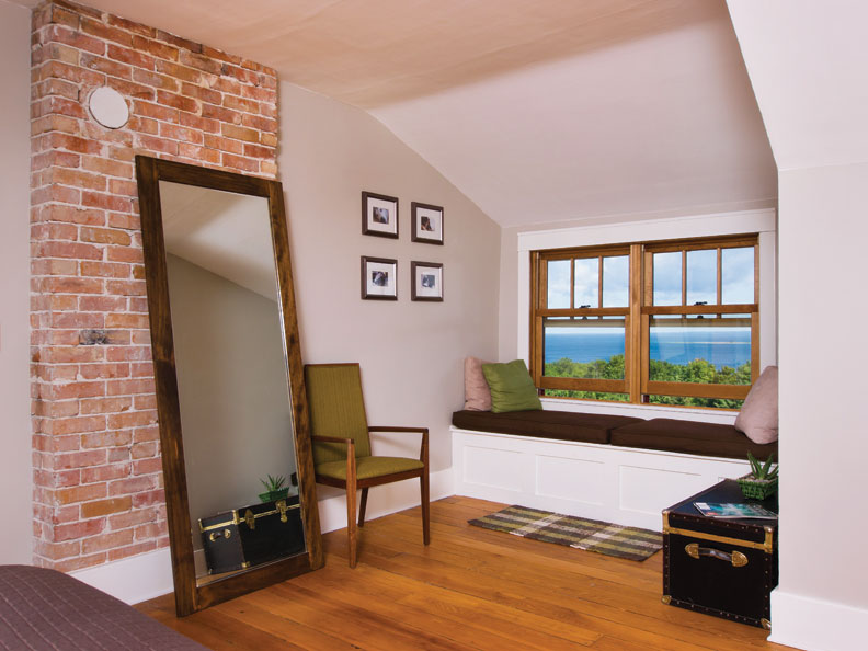 A built-in window seat also takes in views of the bay beyond.