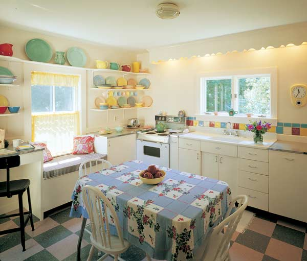 A cheery blend of new and not very old, this 1950-look kitchen was designed around metal cabinets and the colors in vintage tablecloths and LuRay dinnerware. Photo courtesy of Brian Vanden Brink.