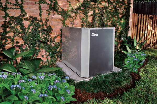 A ClimateMaster outdoor, split-system heat pump, the building's heating and cooling plant.