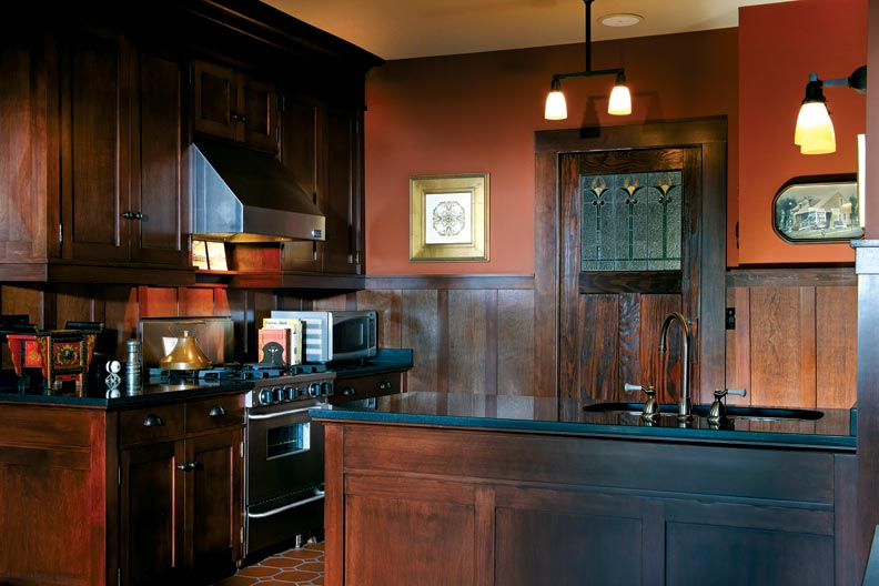 A connection with a previous owner led Gary to the leaded glass panels that once graced the pocket door and built-in cabinet in the dining room; he had new ones fabricated to match for the kitchen.
