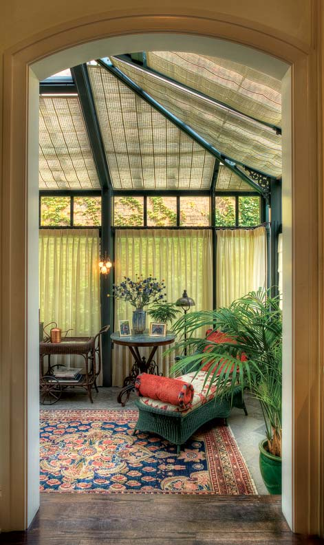 A conservatory contributes an upscale Victorian-era detail.