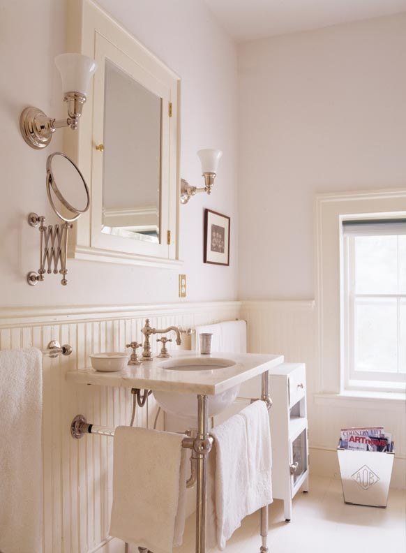 A console sink and nickel-plated accessories recall the early days of indoor plumbing.