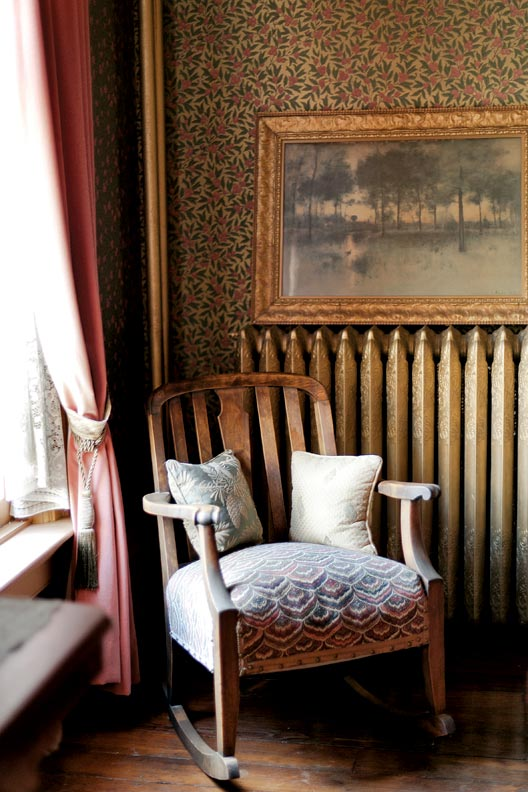 A cozy antique rocker in the front parlor.