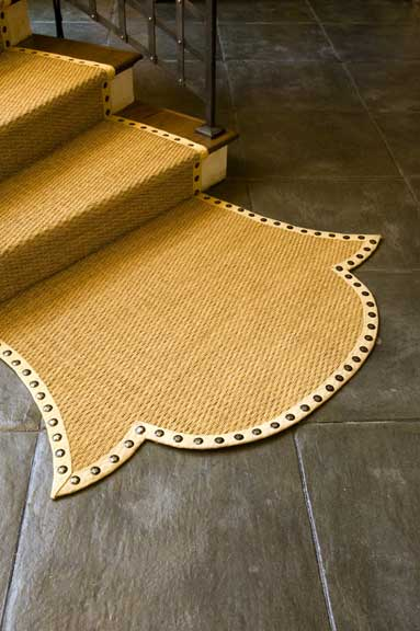 """A """"dragon's tail"""" is a whimsical coda on the stair runner: Barry Dixon added pizzazz to the otherwise undistinguished hall. (Photo: Edward Addeo)"""