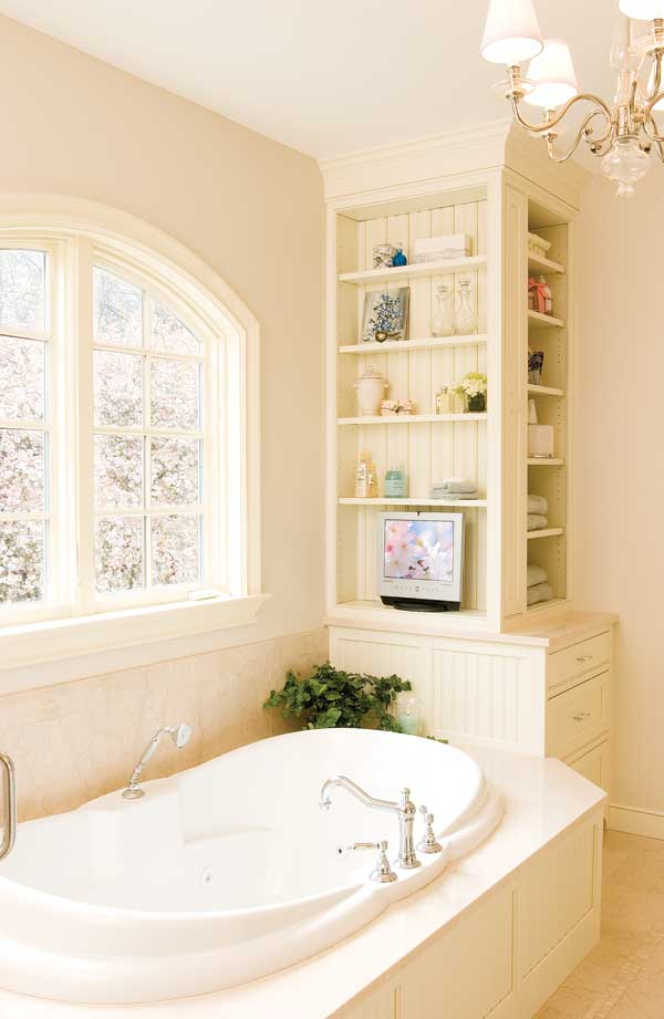 A fitted and furnished Colonial Revival bathroom has cabinetwork by Crown Point.