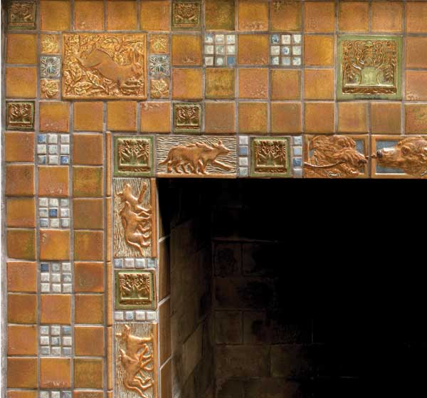 A grid of plain and deco tiles with nature themes in a fireplace by Terra Firma.