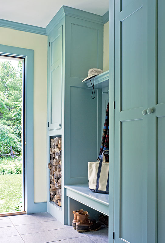 A mudroom that opens out onto a path to the garden.