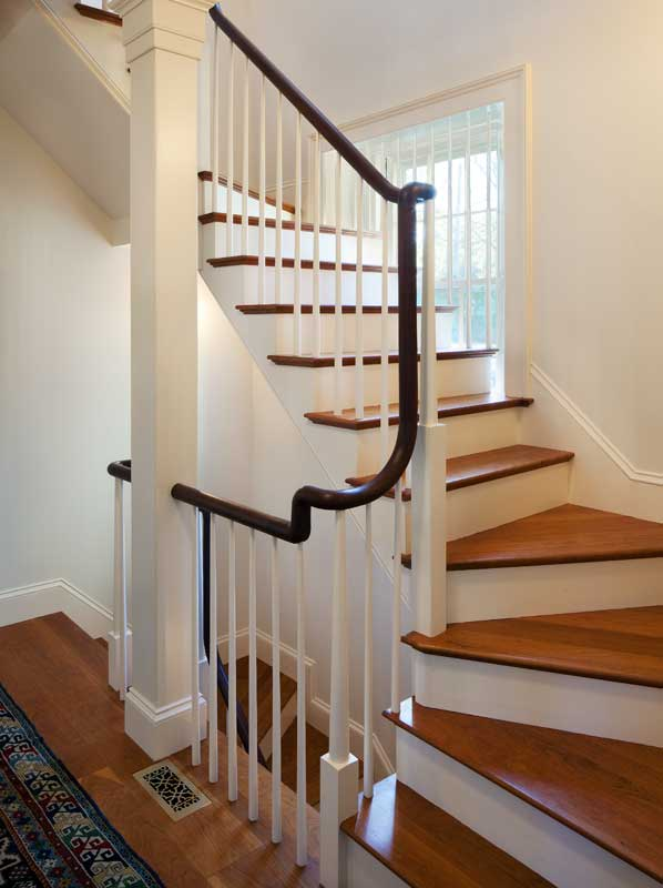 A new back stair leads from the expanded kitchen to guest rooms above.