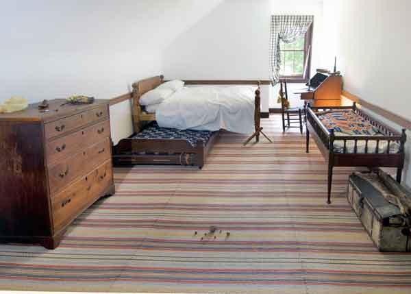 A newly reproduced list (rag) rug in the boys' bedroom at Locust Grove (1792) in Louisville, Kentucky; S and Z twists in the stripes are common design elements. By The Weavery
