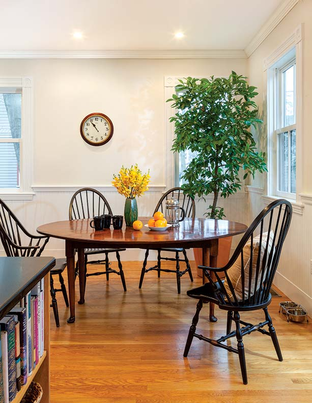 A pad-footed table and Windsor chairs by Warren Chair works are New England classics at home even in a Victorian period house.