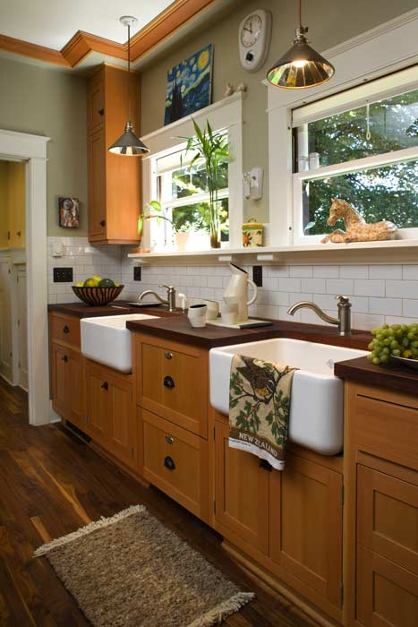 A pair of farmhouse sinks was installed under the windows, with a dishwasher hidden between. Photo: William Wright.