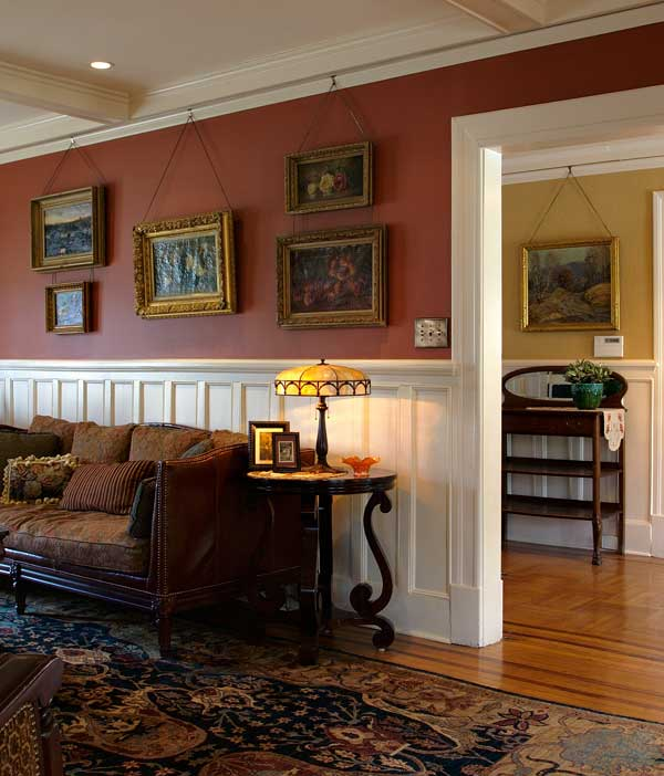 A pleasing and changeable arrangement of fine art hangs from plain hooks and wire. Photo: Peter Sorantin