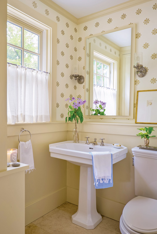 A powder room is in keeping with the color scheme.