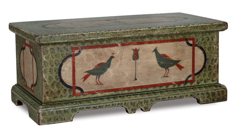 A reproduction of a 1765 miniature marriage chest.