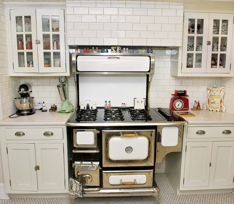 A reproduction stove from Heartland sits in an alcove.