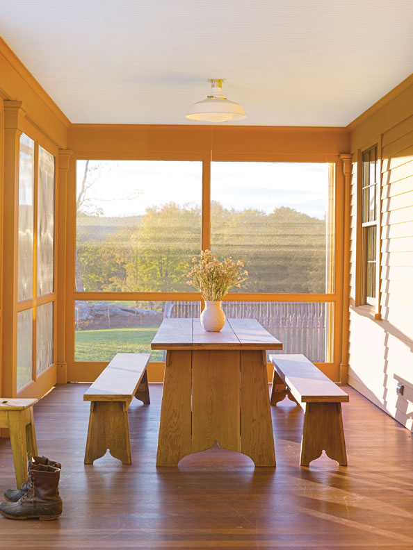 A screened porch provides a pleasant area to enjoy the outdoors nine months of the year.