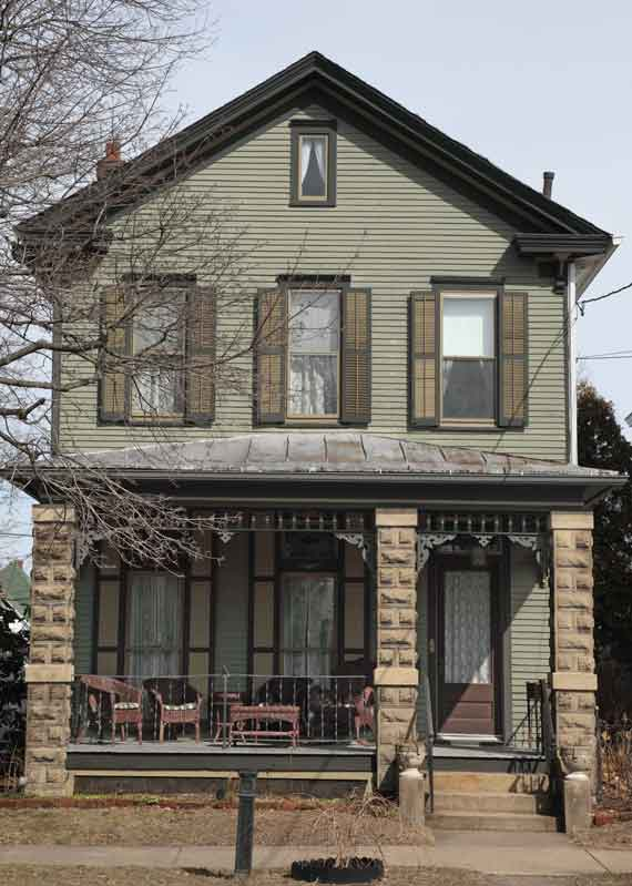 A simple, front-gabled Victorian is the guest house next door to the Queen Anne.