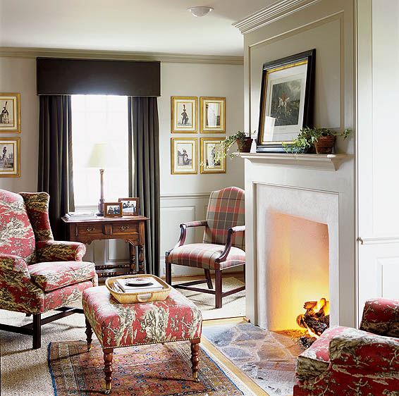 A sitting room offers Colonial detailing, including this warming hearth.