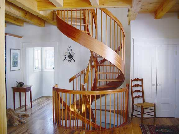 A spiral-helix wood stair from York makes best use of a second-floor hall.