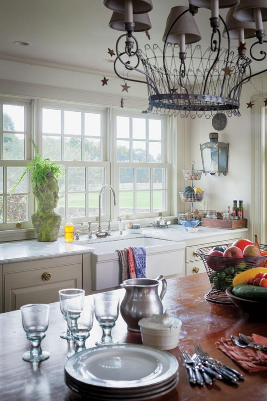 A timeless style comes from the lack of overhead cabinets in the kitchen.