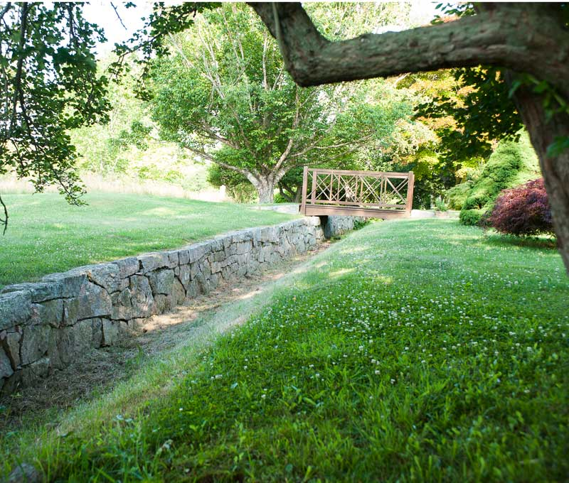 A turf ditch, the ha-ha is an English garden device that keeps livestock out of the garden while maintaining an unbroken view.