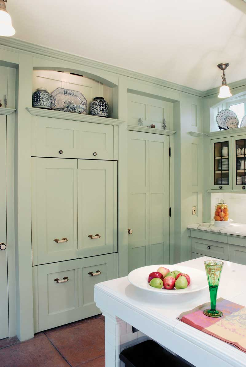 A walk-in pantry is behind the door to the right of the built-in refrigerator.