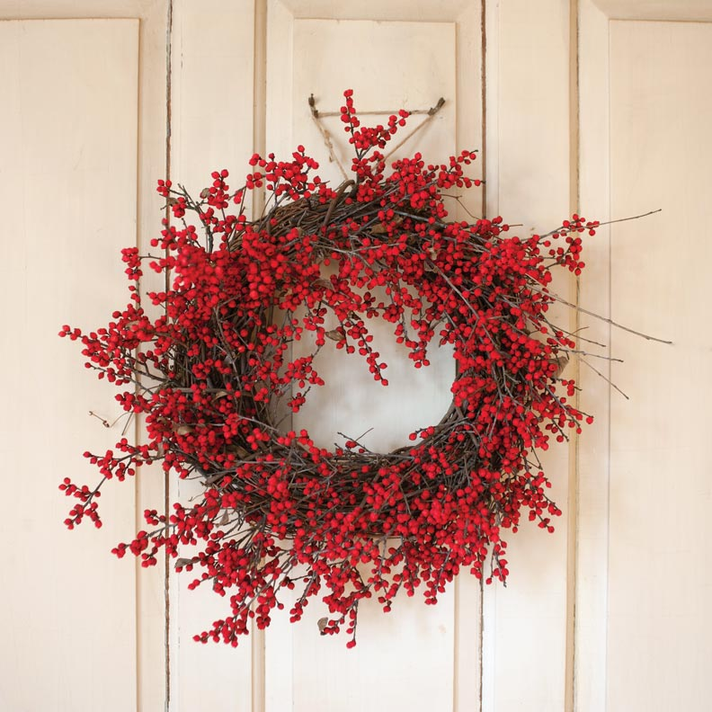 A wreath of winterberries woven into plain twigs.