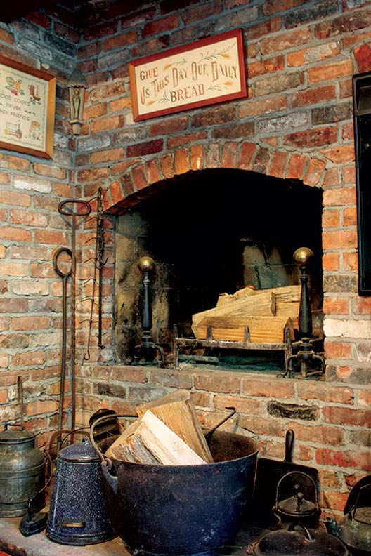 In their kitchen, the Callahans constructed a hearth out of bricks they'd saved for years before moving in.